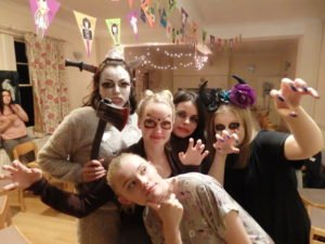 5 female students dressed up for a halloween party