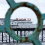 The Brighton pier through the fence
