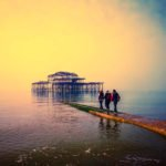 West pier sunset with people