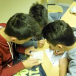 3 male students in a small group activity