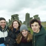 4 students on a trip to stonehenge