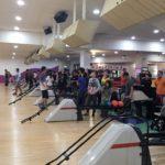 Students bowling at bowling evening