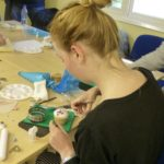 Student cake decorating class