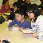 Teen class doing a class activity