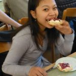 Student eating a cream tea