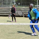 Double tennis match Loxdale students getting competitive