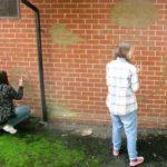 Students drawing graffiti