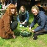 3 female students gardening