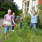 Students weeding the garden