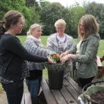 4 female students doing gardening work