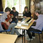 4 students compose a song in class