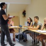 Students listening to a teacher speak