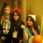 3 Female students dressing up at halloween