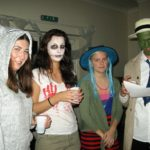 4 students at a halloween social event