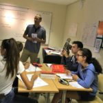 A teacher teaching his class