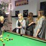 Students playing pool at the local pub