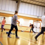 Students playing badminton in the sports hall 01
