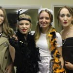 Students dressing up for a murder mystery party