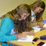 2 female students doing class work