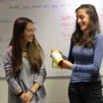 2 female students presenting their projects
