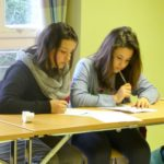 2 female students doing classwork