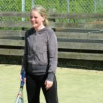 Female student playing tennis at Hove Park