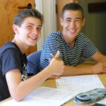 2 male students looking happy about work 01