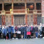 A group on a trip to the Globe Theatre