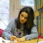 female student doing class work