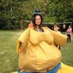 Sumo wrestler activity - girl dressed up in a suit