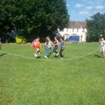 young learners playing skipping rope in the garden at loxdale