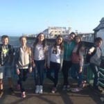 young learners standing close to Brighton pier