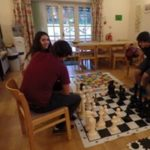 Young learners playing boardgames at loxdale language school