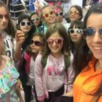 group shot! lots of young learner female students posing with sunglasses