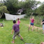 Students shooting from a bow and arrow - archery lessons at loxdale