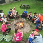 Young learner students around a campfire